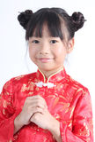 Cute girl wearing red Chinese suit Stock Photography