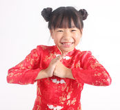 Cute girl wearing red Chinese suit Stock Photos