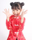 Cute girl wearing red Chinese suit Royalty Free Stock Photography