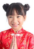 Cute girl wearing red Chinese suit Stock Photo