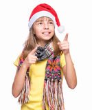 Cute girl wearing Santa Claus hat Stock Image
