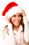 Cute Girl Wearing Santa Hat. On Isolated White Background Royalty Free Stock Photo