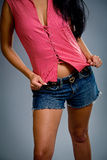 Cute girl wearing shorts royalty free stock photography
