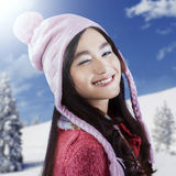 Cute girl wearing sweater give a wink Stock Photography