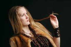 Cute girl wearing tribal style fur coat Royalty Free Stock Photo