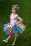 Cute girl wearing tutu and posing in the garden. Royalty Free Stock Images