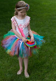 Cute girl wearing tutu and posing in the garden. Royalty Free Stock Photography