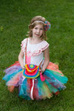 Cute girl wearing tutu and shirt with parrot. Royalty Free Stock Images
