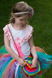 Cute girl wearing tutu and shirt with parrot. Royalty Free Stock Photo