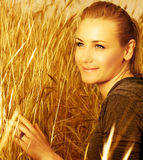 Cute girl on wheat field Stock Photo