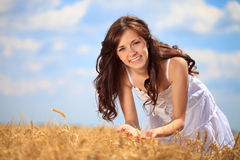Cute girl in wheat field Royalty Free Stock Image