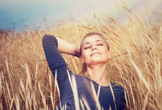 Cute girl on wheat field Royalty Free Stock Images