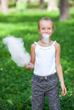 Cute girl with white cotton candy Royalty Free Stock Images