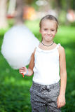 Cute girl with white cotton candy Royalty Free Stock Photography