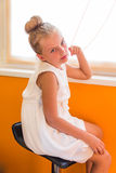 Cute girl in white dress royalty free stock image