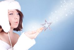 Cute  girl in white hat blowing a snow Stock Photo
