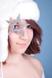 Cute girl in white hat looking through a star Stock Photos
