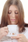 Cute girl with white mug and plate Stock Image