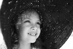 Cute girl in a wide hat Royalty Free Stock Image