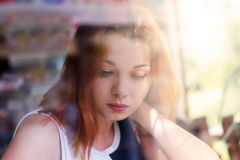 Cute Girl in the Window Royalty Free Stock Image