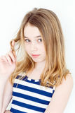 Cute girl winging hair on the finger. Cute blond girl winging hair on the finger stock photos