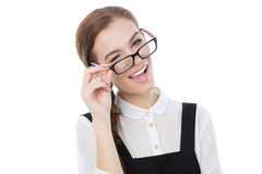 Cute girl winks at the camera. Copy space available. Royalty Free Stock Photography