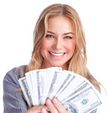 Cute girl winning money. Closeup portrait of cute smiling girl winning money, financial prize in lottery, isolated on white background, wealth concept Royalty Free Stock Photo