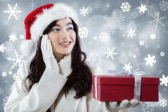 Cute girl in winter clothes get a gift Stock Photo