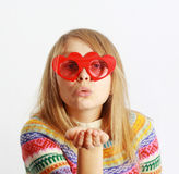 Cute Girl With Red Heart-shaped Glasses Blowing Ki Royalty Free Stock Photos