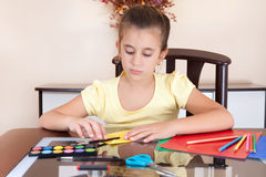Cute girl working on her art project Stock Image
