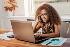 Cute girl working on a laptop. Smiling stock images