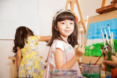 Cute girl working on a painting Stock Photos