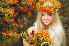 Cute girl in a wreath of Rowan Stock Photo