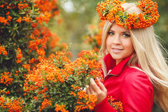 Cute girl in a wreath of Rowan Royalty Free Stock Image