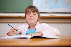 Cute girl writing Royalty Free Stock Photography