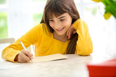 Cute girl writing a letter Stock Photography