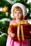 Cute girl with xmas gifts Royalty Free Stock Photography