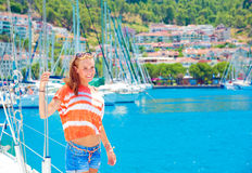 Cute girl in yacht harbor Stock Image