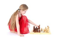 Cute girl 9 years old  play in chess. On white Royalty Free Stock Photo