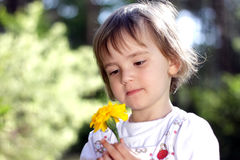 Cute girl with yellow flower Stock Photos