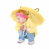 Cute girl with yellow umbrella Stock Photography