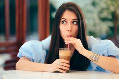 Summer Woman Drinking Fruit Juice in a Restaurant stock photos