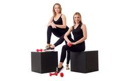 Cute girlfriends-athletes posing at camera Royalty Free Stock Image