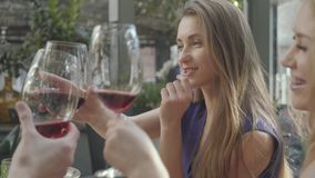 Cute girlfriends chatting in the restaurant, spend time together. Elegant woman with long hair telling her story to stock video