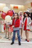 Cute girls with balloons stands with mannequins Royalty Free Stock Photography