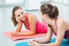 Cute girls chatting at the gym Stock Photos