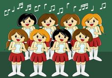 Cute Girls' Choir. Singing christmas carols Royalty Free Stock Photo