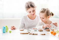 Cute girls decorating Easter cookies Royalty Free Stock Images