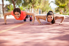 Cute girls doing pushups Royalty Free Stock Photo
