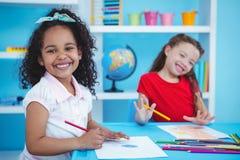 Cute girls drawing Stock Photos